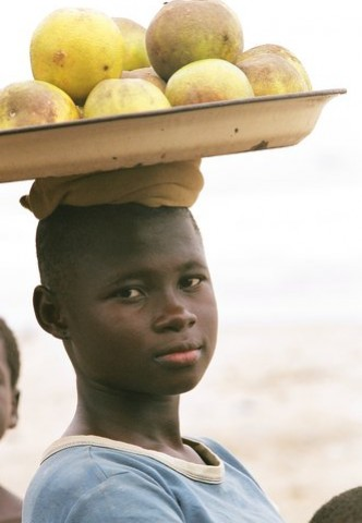 boy-carrying-fruit